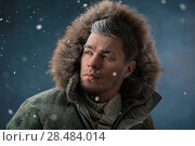 Купить «Handsome man wearing jacket with fur hood in winter snow at night», фото № 28484014, снято 25 сентября 2013 г. (c) Ingram Publishing / Фотобанк Лори