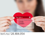 Купить «Love search. Young woman holding red heart with love search options», фото № 28484054, снято 8 декабря 2012 г. (c) Ingram Publishing / Фотобанк Лори