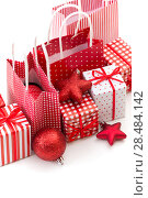 Купить «Gift boxes with xmas presents wrapped in red paper with ornament on white background», фото № 28484142, снято 2 ноября 2012 г. (c) Ingram Publishing / Фотобанк Лори