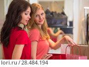 Купить «Two young women shopping in mall», фото № 28484194, снято 22 сентября 2013 г. (c) Ingram Publishing / Фотобанк Лори
