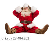 Купить «Hilarious and funny Santa Claus confused while sitting on a white background full length», фото № 28484202, снято 17 января 2013 г. (c) Ingram Publishing / Фотобанк Лори