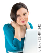 Купить «Portrait of young woman dreaming in front of laptop», фото № 28484242, снято 17 ноября 2012 г. (c) Ingram Publishing / Фотобанк Лори