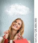 Купить «Shopping woman holding bags on studio background with thoughts cloud overhead», фото № 28484390, снято 22 сентября 2013 г. (c) Ingram Publishing / Фотобанк Лори