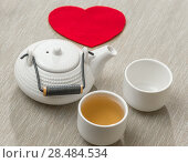 Купить «Valentine's day surprice for couple. Romantic tea set with red heart», фото № 28484534, снято 19 декабря 2012 г. (c) Ingram Publishing / Фотобанк Лори
