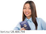 Купить «Portrait of confident young business woman holding passport», фото № 28484794, снято 2 февраля 2013 г. (c) Ingram Publishing / Фотобанк Лори