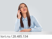 Купить «Beautiful business woman talking on cell phone while looking at copyspace at her desk», фото № 28485134, снято 2 февраля 2013 г. (c) Ingram Publishing / Фотобанк Лори
