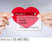 Купить «Love search. Female hands holding red heart with love search options», фото № 28485882, снято 8 декабря 2012 г. (c) Ingram Publishing / Фотобанк Лори