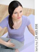 Купить «Portrait of healthy young lady practising yoga exercise - Spine twisting pose», фото № 28485898, снято 27 ноября 2012 г. (c) Ingram Publishing / Фотобанк Лори