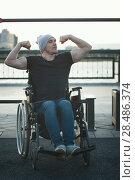 Купить «Muscular disabled man in wheelchair in front of the crossbar outdoors», фото № 28486374, снято 28 мая 2018 г. (c) Константин Шишкин / Фотобанк Лори