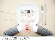 Купить «A young businesswoman honour her sushi platter with Japanese manner protocol», фото № 28486674, снято 11 января 2012 г. (c) Ingram Publishing / Фотобанк Лори