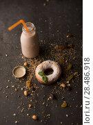 Купить «Sugar powder Donut with mint leaf and milk bottle on dark stone background», фото № 28486918, снято 12 февраля 2015 г. (c) Ingram Publishing / Фотобанк Лори