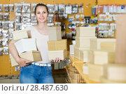 Happy female with other boxes at shop. Стоковое фото, фотограф Яков Филимонов / Фотобанк Лори