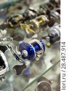Купить «Close-up photo of variety baitcasting reel», фото № 28487914, снято 16 января 2018 г. (c) Яков Филимонов / Фотобанк Лори