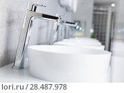 Picture of ceramic wash basin with chrome tap in store. Стоковое фото, фотограф Яков Филимонов / Фотобанк Лори