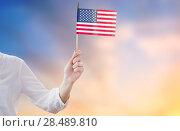 Купить «close up of woman holding american flag in hand», фото № 28489810, снято 28 мая 2015 г. (c) Syda Productions / Фотобанк Лори