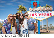 Купить «friends taking selfie by monopod at las vegas sign», фото № 28489814, снято 27 августа 2015 г. (c) Syda Productions / Фотобанк Лори
