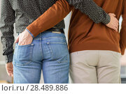 Купить «close up of hugging male gay couple», фото № 28489886, снято 2 ноября 2017 г. (c) Syda Productions / Фотобанк Лори