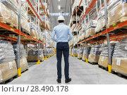 Купить «businessman in helmet at warehouse», фото № 28490178, снято 9 декабря 2015 г. (c) Syda Productions / Фотобанк Лори