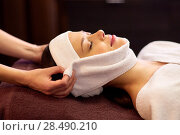Купить «woman having face massage with towel at spa», фото № 28490210, снято 26 января 2017 г. (c) Syda Productions / Фотобанк Лори