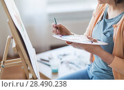 Купить «artist with palette and brush painting at studio», фото № 28490238, снято 1 июня 2017 г. (c) Syda Productions / Фотобанк Лори