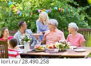 Купить «happy family having dinner or summer garden party», фото № 28490258, снято 9 июля 2017 г. (c) Syda Productions / Фотобанк Лори