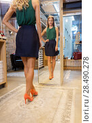 Купить «young woman in high-heeled shoes at store mirror», фото № 28490278, снято 22 сентября 2017 г. (c) Syda Productions / Фотобанк Лори