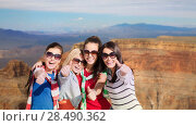Купить «teenage girls or young women showing thumbs up», фото № 28490362, снято 31 августа 2013 г. (c) Syda Productions / Фотобанк Лори