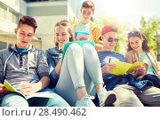 Купить «group of students with notebooks at school yard», фото № 28490462, снято 21 мая 2016 г. (c) Syda Productions / Фотобанк Лори