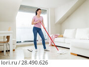 Купить «woman or housewife with mop cleaning floor at home», фото № 28490626, снято 29 апреля 2018 г. (c) Syda Productions / Фотобанк Лори