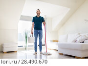 Купить «man with mop and bucket cleaning floor at home», фото № 28490670, снято 10 мая 2018 г. (c) Syda Productions / Фотобанк Лори