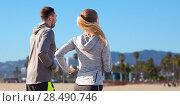 Купить «happy couple running outdoors», фото № 28490746, снято 17 октября 2015 г. (c) Syda Productions / Фотобанк Лори