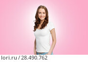 Купить «happy slim woman in white t-shirt over pink», фото № 28490762, снято 17 апреля 2016 г. (c) Syda Productions / Фотобанк Лори