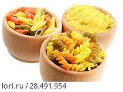 Купить «Wooden bowl of tricolor pasta isolated over white background», фото № 28491954, снято 13 января 2013 г. (c) Ingram Publishing / Фотобанк Лори