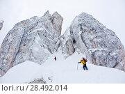 Купить «Two climbers approach to the steep face of the Cinque Torri, Dolomiti, Italy», фото № 28492014, снято 25 июня 2019 г. (c) Ingram Publishing / Фотобанк Лори