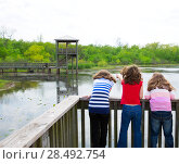 Купить «Kid children girls looking and pointing at park lake in Texas rear view», фото № 28492754, снято 22 октября 2018 г. (c) Ingram Publishing / Фотобанк Лори