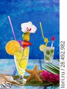 Купить «Mojito and lemon lime Cocktails in tropical Caribbean blue wood with starfish flowers and seashells», фото № 28492982, снято 27 марта 2019 г. (c) Ingram Publishing / Фотобанк Лори
