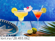 Купить «Cocktails mexican Margarita and sex on the beach on blue Caribbean wood», фото № 28493062, снято 25 апреля 2019 г. (c) Ingram Publishing / Фотобанк Лори