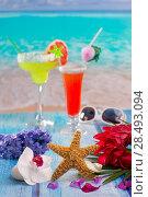 Купить «Cocktails margarita sex on the beach in colorful tropical house with flowers starfish and seashells», фото № 28493094, снято 27 марта 2019 г. (c) Ingram Publishing / Фотобанк Лори