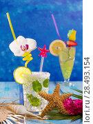 Купить «Mojito and lemon lime Cocktails in tropical Caribbean blue wood with starfish flowers and seashells», фото № 28493154, снято 27 марта 2019 г. (c) Ingram Publishing / Фотобанк Лори