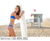 Купить «Beautiful surfer teen girl with surfboard in Santa Monica beach California Lifeguard house», фото № 28494382, снято 20 июня 2019 г. (c) Ingram Publishing / Фотобанк Лори