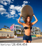 Купить «Brunette surfer teen girl holding surfboard in Santa Monica beach California», фото № 28494454, снято 20 июня 2019 г. (c) Ingram Publishing / Фотобанк Лори