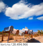 Купить «Grunge mail boxes in a row at California Mohave desert USA», фото № 28494966, снято 12 апреля 2013 г. (c) Ingram Publishing / Фотобанк Лори
