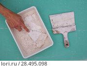Купить «Platering tools for plaster like plaste trowel spatula on green drywall plasterboard», фото № 28495098, снято 10 марта 2013 г. (c) Ingram Publishing / Фотобанк Лори