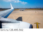 Купить «Airplane wing in airport with aircraft background with blue sky», фото № 28495502, снято 24 мая 2013 г. (c) Ingram Publishing / Фотобанк Лори