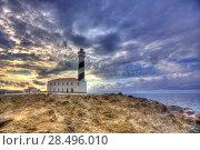 Купить «Cap de Favaritx sunset lighthouse cape in Mahon at Balearic Islands of Spain», фото № 28496010, снято 28 мая 2013 г. (c) Ingram Publishing / Фотобанк Лори