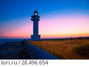 Formentera sunset in Barbaria cape lighthouse at Balearic Mediterranean islands. Стоковое фото, фотограф Tono Balaguer / Ingram Publishing / Фотобанк Лори
