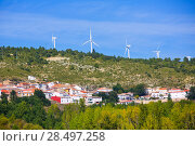 Cuenca San Martin de Boniches village with windmills in early autumn Spain (2013 год). Стоковое фото, фотограф Tono Balaguer / Ingram Publishing / Фотобанк Лори