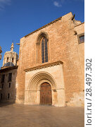 Купить «Valencia Cathedral romanesque door Puerta del Palau Almoina and Micalet Seu at Spain», фото № 28497302, снято 10 сентября 2013 г. (c) Ingram Publishing / Фотобанк Лори
