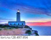 La Mola Cape Lighthouse Formentera at sunrise in Balearic Islands. Стоковое фото, фотограф Tono Balaguer / Ingram Publishing / Фотобанк Лори