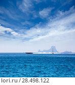 Купить «Es Vedra Ibiza silhouette with boats view from Formentera in Balearic islands», фото № 28498122, снято 3 июня 2013 г. (c) Ingram Publishing / Фотобанк Лори